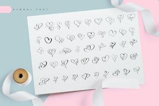 Adorablemente Símbolo Flourish Hearts Fuente